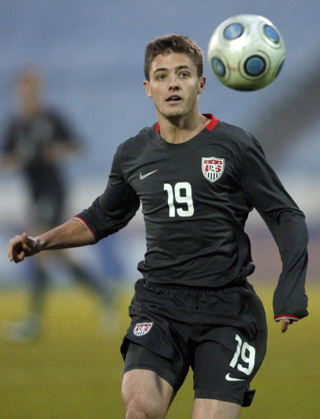 FILE - In this Nov. 14, 2009 file photo, Robbie Rogers, of the United States, eyes the ball during a friendly soccer match against Slovakia in Bratislava, Slovakia. Rogers is joining the Los Angeles Galaxy of Major League Soccer in another step by gay athletes. Rogers tells The Associated Press his fears about returning to soccer were eased by the support he received from family, fans and players, including Galaxy star Landon Donovan. (AP Photo/Petr David Josek, File)