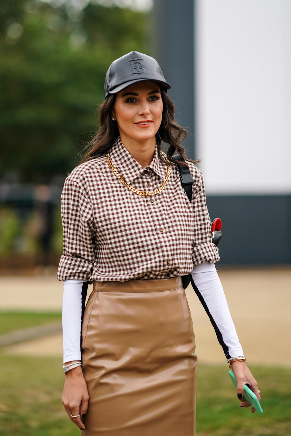 Leather elevates a ball cap while keeping the cool factor. And those loose curls? Gorgeous.