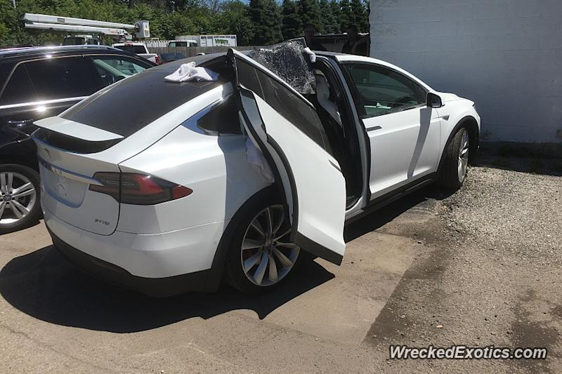 Ouch! Don't leave the garage with your Tesla Falcon Wing doors open