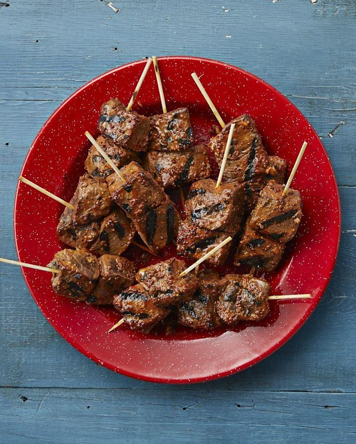 """<p>Is there a better day than Father's Day to get out the grill? If grilling is Dad's favorite pastime, he'll love making these mouthwatering Garlic-Mustard Grilled Beef Skewers. </p><p><a href=""""https://www.thepioneerwoman.com/food-cooking/recipes/a34590635/bobby-flay-garlic-mustard-grilled-beef-skewers/"""" rel=""""nofollow noopener"""" target=""""_blank"""" data-ylk=""""slk:Get the recipe."""" class=""""link rapid-noclick-resp""""><strong>Get the recipe.</strong></a></p><p><a class=""""link rapid-noclick-resp"""" href=""""https://go.redirectingat.com?id=74968X1596630&url=https%3A%2F%2Fwww.walmart.com%2Fsearch%2F%3Fquery%3Dskewers&sref=https%3A%2F%2Fwww.thepioneerwoman.com%2Fholidays-celebrations%2Fg36333267%2Ffathers-day-activities%2F"""" rel=""""nofollow noopener"""" target=""""_blank"""" data-ylk=""""slk:SHOP SKEWERS"""">SHOP SKEWERS</a></p>"""