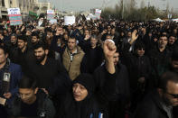 """Protesters chant slogans during a demonstration over the U.S. airstrike in Iraq that killed Iranian Revolutionary Guard Gen. Qassem Soleimani in Tehran, Iran, Jan. 3, 2020. Iran has vowed """"harsh retaliation"""" for the U.S. airstrike near Baghdad's airport that killed Tehran's top general and the architect of its interventions across the Middle East, as tensions soared in the wake of the targeted killing. (AP Photo/Vahid Salemi)"""