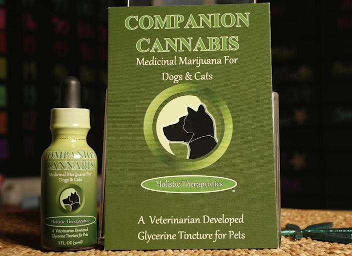 In this photo taken Thursday, May 30, 2013, Companion Cannabis, by Holistic Therapeutics, a Marijuana medicinal tincture for dogs and cats is seen at La Brea Compassionate Caregivers, a medical marijuana dispensary in Los Angeles Thursday, May 30, 2013. Stories abound about changes in sick and dying pets after they've been given marijuana. There is a growing movement, led by Los Angeles veterinarian Doug Kramer, to make it more widely available. Others, however, urge caution until there's better science behind it. (AP Photo/Damian Dovarganes)