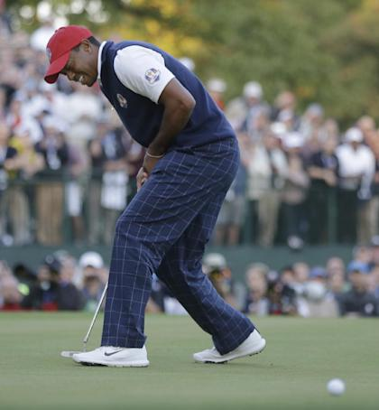 Tiger Woods reacts after missing a birdie putt on the 18th hole to lose a fourball match. (AP)