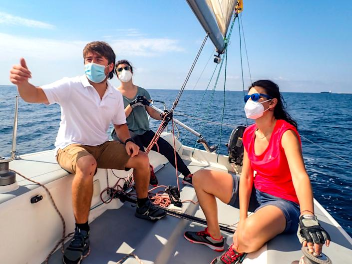 Wearing a mask adds another level of protection when boating with people outside your household. (Photo: Miquel Benitez via Getty Images)