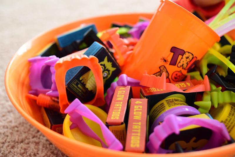 Mom Natalie Brennenman provides a bowl of non-food treats for trick-or-treaters as part of the Teal Pumpkin Project.