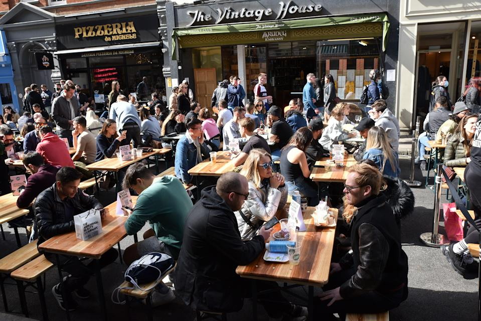 People enjoying some alfresco dining in Soho, London, in April (Barcroft Media via Getty Images)