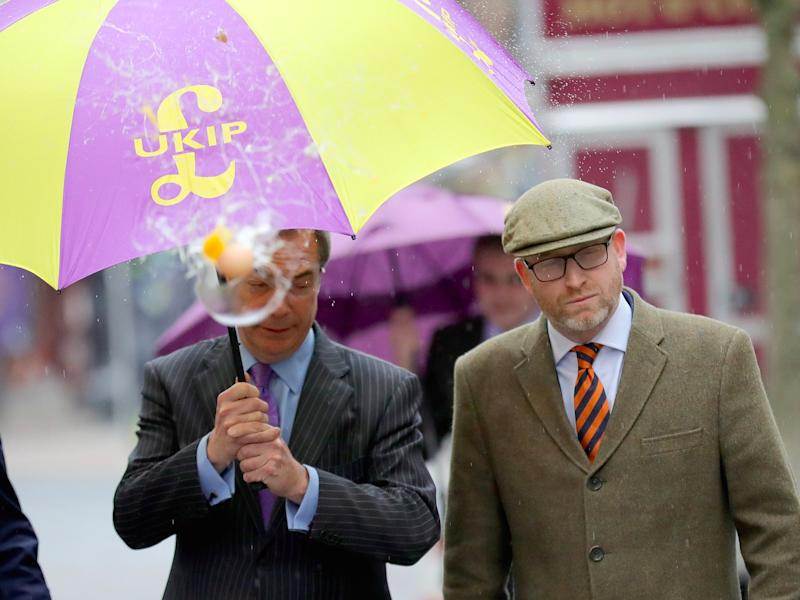 UKIP leader Paul Nuttall (R) and former Leader Nigel Farage MEP dodge an egg thrown by a youth as they arrive in Stoke-On-Trent for a public meeting this evening on February 6, 2017 in Stoke, England. The Stoke-on-Trent central by-election has been called after sitting Labour MP Tristram Hunt resigned from his seat to be a museum director. The seat has always been a Labour stronghold but will see fierce competition from The United Kingdom Independence Party (UKIP) as they target people who voted for Brexit and the tradtional Labour working classes. (Photo by )