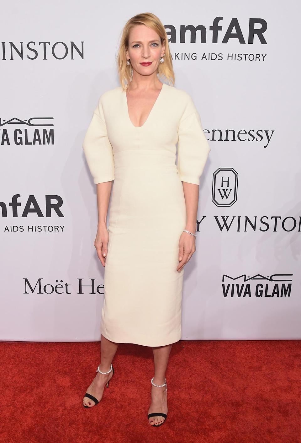 """<p>The """"Kill Bill"""" actress looked perfectly styled in this cream, puff-sleeved number.<i> [Photo: Getty]</i><br></p>"""