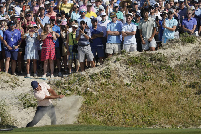 Brooks Koepka hits out of a bunker on the 10th hole during the final round at the PGA Championship golf tournament on the Ocean Course, Sunday, May 23, 2021, in Kiawah Island, S.C. (AP Photo/Matt York)