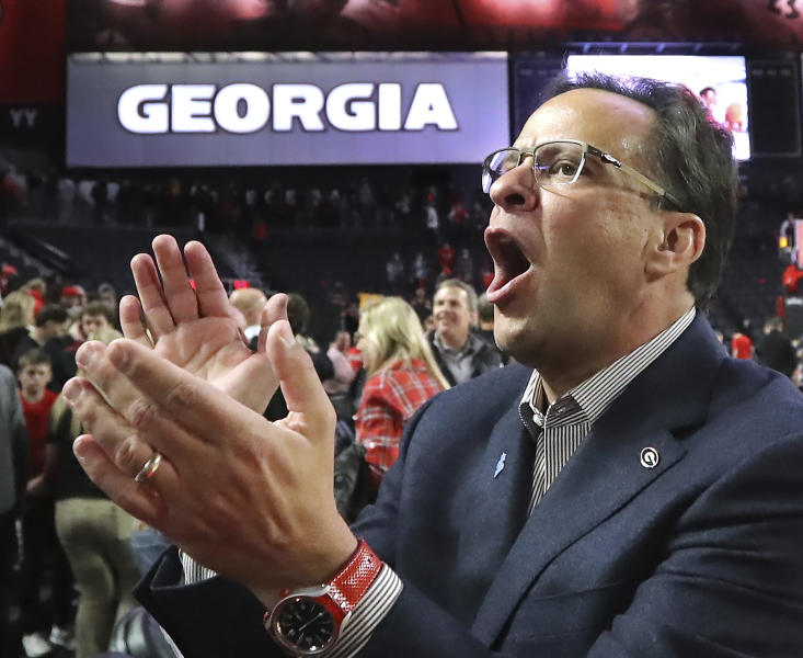 Georgia head coach Tom Crean thanks the fans while celebrating a 63-48 victory over Texas A&M in a NCAA college basketball game on Saturday, Feb. 1, 2020, in Athens. (Curtis Compton/Atlanta Journal-Constitution via AP)