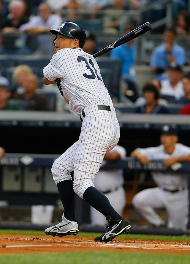 NEW YORK, NY - AUGUST 12: Ichiro Suzuki #31 of the New York Yankees flys out in the first inning against the Los Angeles Angels of Anaheim at Yankee Stadium on August 12, 2013 in the Bronx borough of New York City. The Yankees defeated the Angels 2-1. (Photo by Mike Stobe/Getty Images)