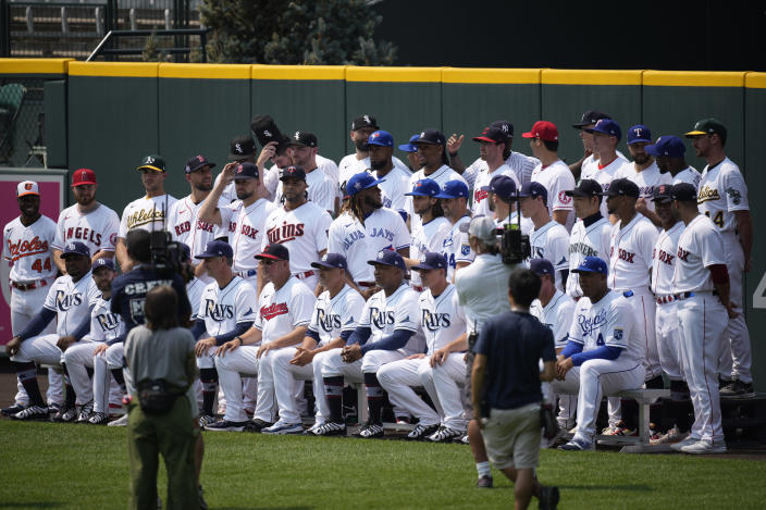 The American League baseball All Stars pose for a team picture in centerfield at Coors Field, Monday, July 12, 2021, in Denver. (AP Photo/David Zalubowski)