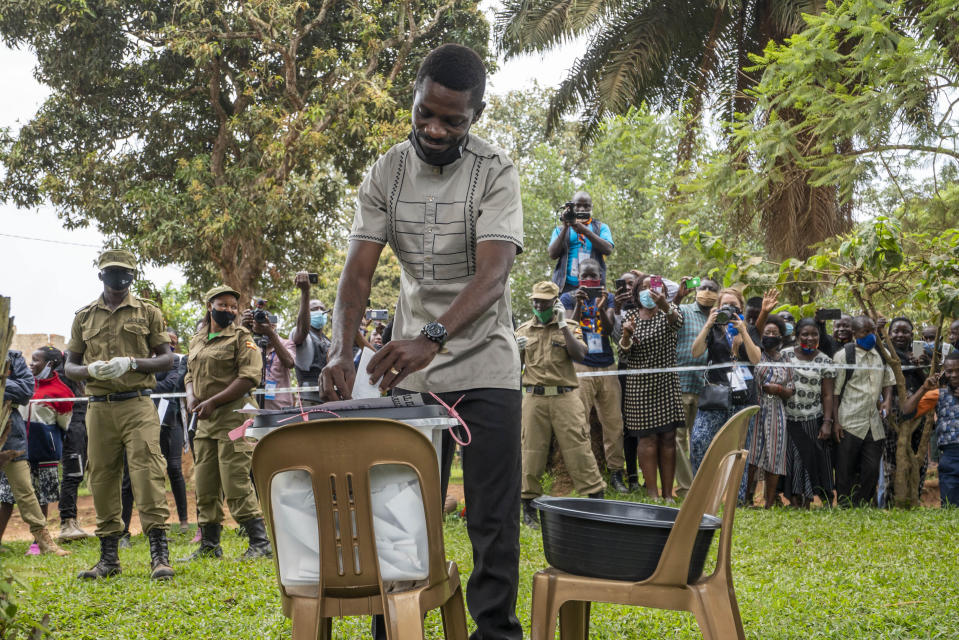 Uganda's leading opposition challenger Bobi Wine votes in Kampala, Uganda, Thursday, Jan. 14, 2021. Ugandans are voting in a presidential election tainted by widespread violence that some fear could escalate as security forces try to stop supporters of Wine from monitoring polling stations.(AP Photo/Jerome Delay)