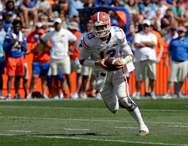 "Florida quarterback <a class=""link rapid-noclick-resp"" href=""/ncaaf/players/263157/"" data-ylk=""slk:Feleipe Franks"">Feleipe Franks</a> runs with the ball during an NCAA spring college football intrasquad game, Saturday, April 14, 2018, in Gainesville, Fla. (AP Photo/John Raoux)"