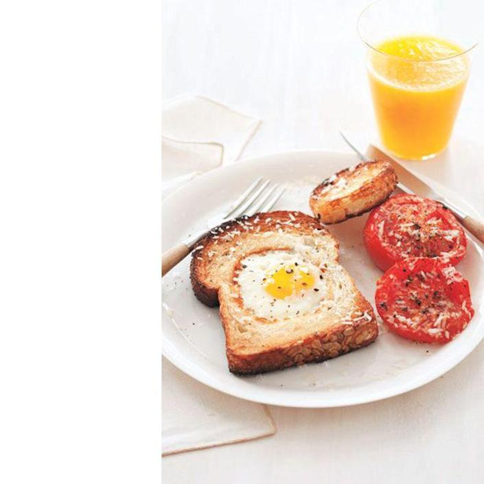 """<p>Dad used to make this cheery breakfast for you when you were a kid. Now it's time to return the favor.</p><p><a href=""""https://www.womansday.com/food-recipes/food-drinks/recipes/a11647/egg-in-a-hole-broiled-tomatoes-recipe-122825/"""" rel=""""nofollow noopener"""" target=""""_blank"""" data-ylk=""""slk:Get the Egg in a Hole With Broiled Tomatoes recipe."""" class=""""link rapid-noclick-resp""""><em>Get the Egg in a Hole With Broiled Tomatoes recipe.</em></a></p>"""