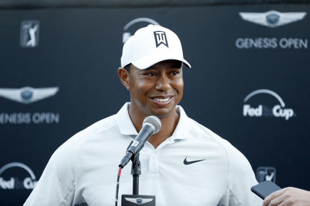 FILE - In this Feb. 16, 2018, file photo, Tiger Woods talks to reporters following his second round of the Genesis Open golf tournament at Riviera Country Club in the Pacific Palisades area of Los Angeles. Tiger Woods and Ernie Els will duel in the Presidents Cup again, this time as captains. Woods and Els have agreed to be captains for the 2019 matches in Melbourne, Australia, according to two people involved in the Presidents Cup. They spoke on condition of anonymity because the captain selections have not been announced. (AP Photo/Ryan Kang, File)