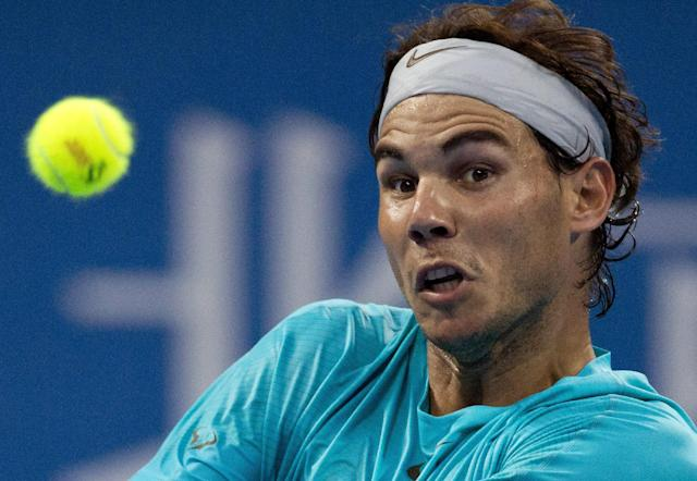 Rafael Nadal of Spain eyes on the ball as he plays against Santiago Giraldo of Colombia during their match of the China Open tennis tournament at the National Tennis Stadium in Beijing, China Tuesday, Oct. 1, 2013. (AP Photo/Andy Wong)