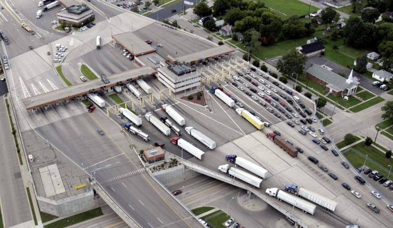 FILE PHOTO -- Vehicles can be seen going through customs entering the US from Sarnia, Canada from the Bluewater bridge in Port Huron, Michigan