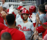 Philadelphia Phillies' Bryce Harper (3) celebrates in the dugout after hitting a two-run home run during the third inning of the team's baseball game against the Atlanta Braves on Friday, June 14, 2019, in Atlanta. (AP Photo/John Bazemore)