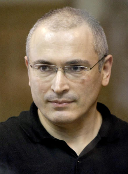 FILE - In this Tuesday May 24, 2011 file photo former Yukos CEO Mikhail Khodorkovsky stands behind a glass wall at a court in Moscow, Russia. The European Court of Human Rights on Thursday July 25, 2013, has dismissed claims that Russian tycoon Mikhail Khodorkovsky was prosecuted for political reasons. But the court said Thursday that Russia unfairly charged him huge tax arrears, and that Russian authorities unfairly sent him and business partner Platon Lebedev to far-away penal colonies. (AP Photo/Misha Japaridze, File)