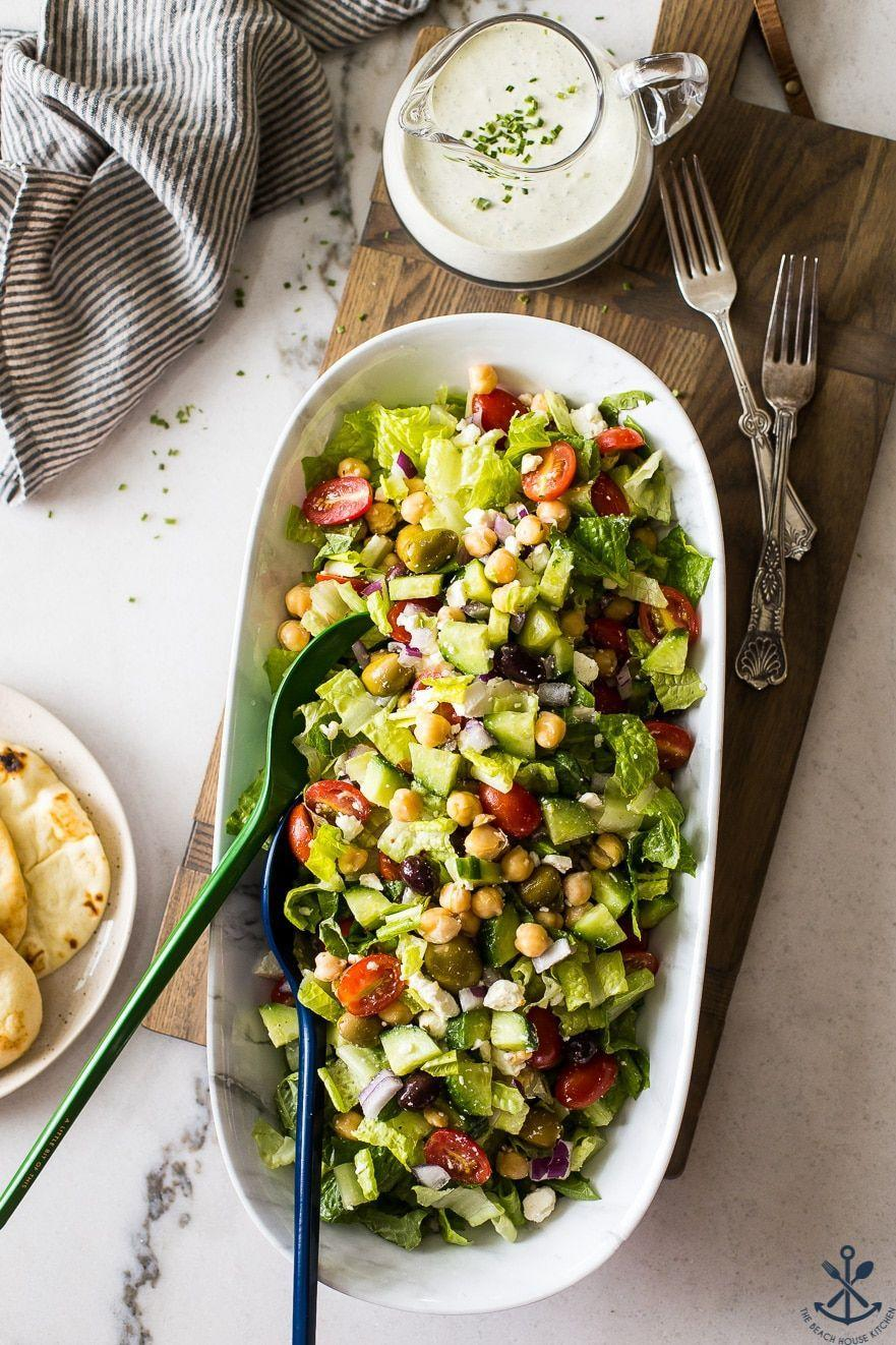 """<p>For a vegetarian side that will leave plant-loving cookout guests satisfied, whip up this protein-packed salad, then top with a bright green goddess dressing. </p><p><a href=""""https://thebeachhousekitchen.com/greek-chickpea-salad-with-green-goddess-dressing/"""" rel=""""nofollow noopener"""" target=""""_blank"""" data-ylk=""""slk:Get the recipe."""" class=""""link rapid-noclick-resp"""">Get the recipe. </a></p>"""