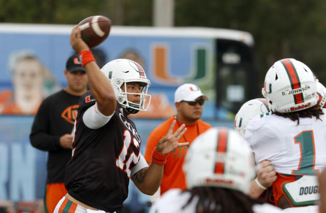 "Quarterback <a class=""link rapid-noclick-resp"" href=""/ncaaf/players/240751/"" data-ylk=""slk:Malik Rosier"">Malik Rosier</a> (12) of the Miami NCAA college football team throws as the team practiced in Davie, Fla., Wednesday, Dec. 27, 2017, for the Orange Bowl to be played against Wisconsin on Dec. 30. (AP Photo/Joe Skipper)"