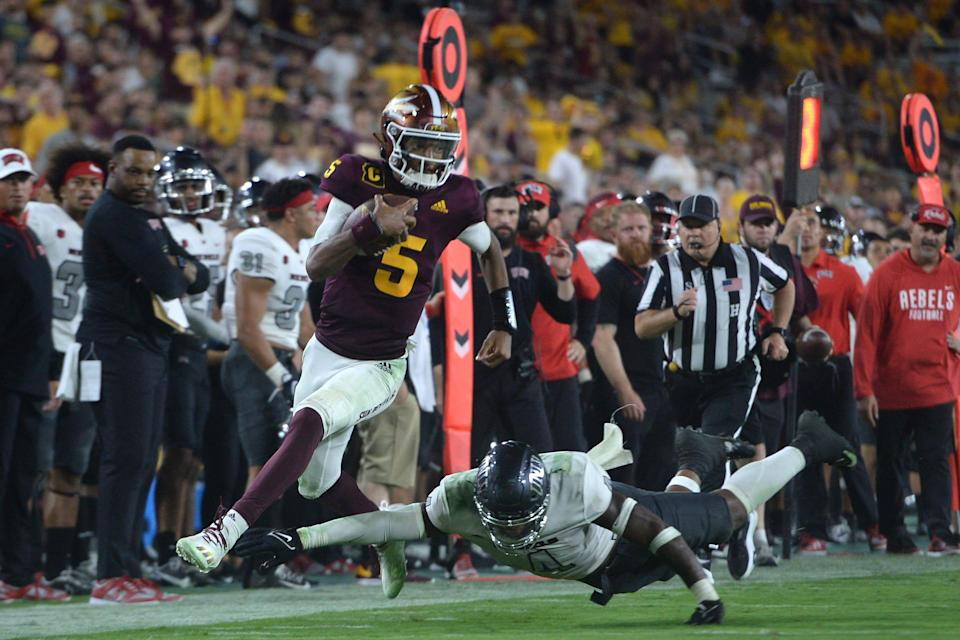 Arizona State quarterback Jayden Daniels escapes a UNLV tackler during their game last week at Sun Devil Stadium as ASU pulled away for a 37-10 win.