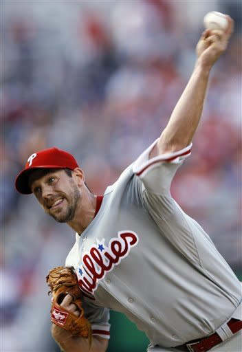 Philadelphia Phillies starting pitcher Cliff Lee delivers in the first inning at Nationals Park during a baseball game against the Washington Nationals, Tuesday, July 31, 2012, in Washington. (AP Photo/Carolyn Kaster)