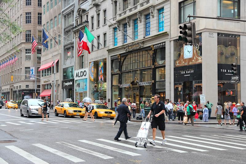 People shop at 5th Avenue, New York. 5th Avenue is ranked the most expensive retail area (per square foot) in the world.