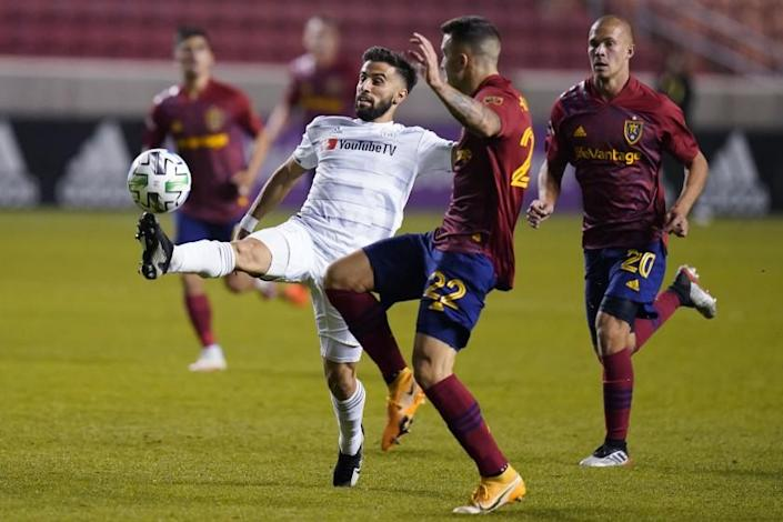 Los Angeles FC forward Diego Rossi, left, controls the ball as Real Salt Lake's Aaron Herrera (22) defends during the second half of an MLS soccer match Sunday, Oct. 4, 2020, in Sandy, Utah. (AP Photo/Rick Bowmer)