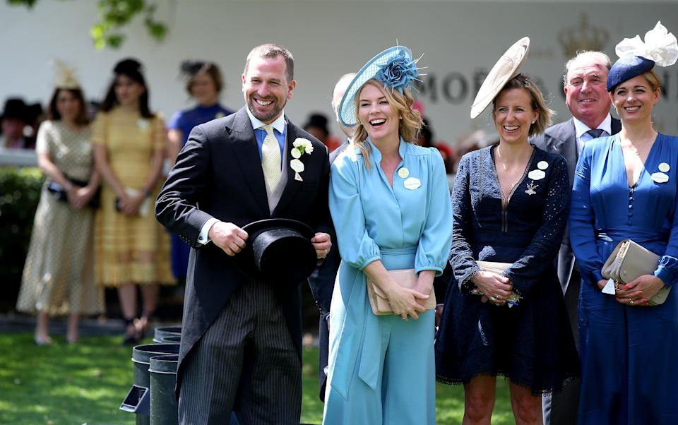 Peter Phillips (left) and Autumn Phillips (centre) at Royal Ascot (PA Archive)
