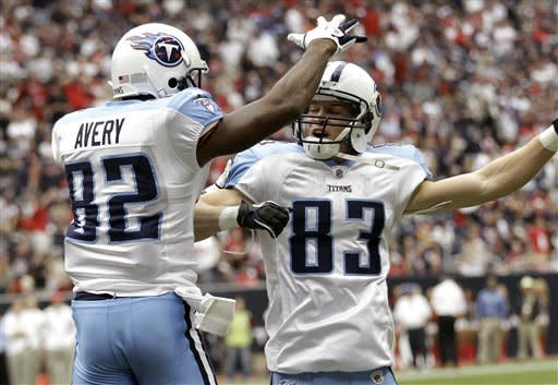 Tennessee Titans wide receiver Donnie Avery (82) and Marc Mariani (83) celebrate Avery's touchdown catch in the second quarter against the Houston Texans in an NFL football game on Sunday, Jan. 1, 2012, in Houston. (AP Photo/David J. Phillip)