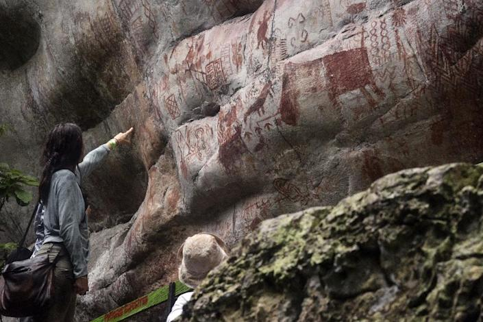 The area is sacred to the indigenous people of the jungle and not everyone has the right to even approach the rock art (AFP Photo/GUILLERMO LEGARIA)