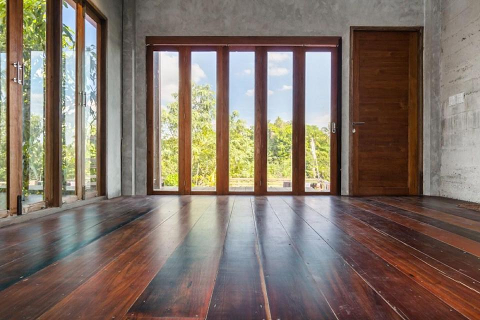 "While the settling of an older home may lead to some variation in its flooring, if you could downhill ski from one side of your home to the other, that's an issue that needs attending to ASAP. ""Floors that have 'whooptidoos,' or up and down hilly floors, are often a sign of floor piers placed too far apart,"" says <a href=""http://www.smokymountainrealtytn.com/Home"" rel=""nofollow noopener"" target=""_blank"" data-ylk=""slk:house-flipper and realtor"" class=""link rapid-noclick-resp"">house-flipper and realtor</a>, <strong>Jodi Moody</strong>, of Smoky Mountain Realty. ""Back when codes didn't exist, floor beams and piers were put further apart to save money and wavy floors are a sure sign a building is not properly supported."""