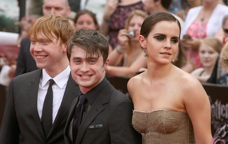 "Actors Rupert Grint, Daniel Radcliffe and Emma Watson attend the premiere of ""Harry Potter and the Deathly Hallows - Part 2"" at Avery Fisher Hall, Lincoln Center on July 11, 2011 in New York City."