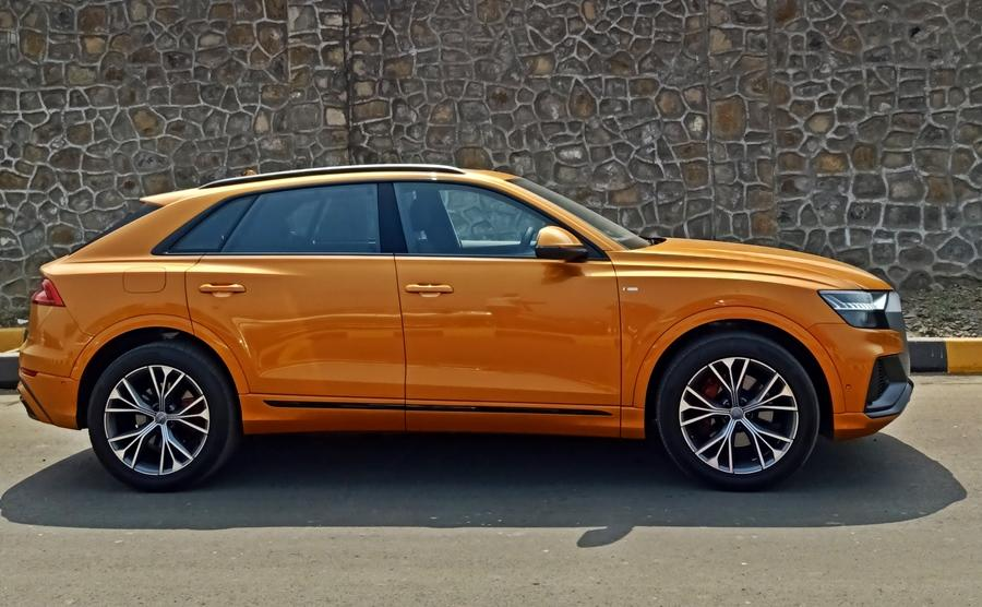 In contrast to the front, the side with the slightly slanting roof, the muscular lines along with the massive 21-inch wheels bring in a coupe-like stance, but the look is better than some other SUVs owing to its smoother shape.