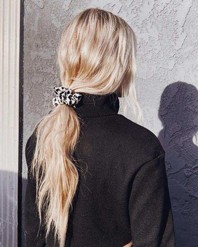 """<p>Still feel like going for a low-key vibe with your ponytail? After lightly spritzing your roots and lengths with a <a href=""""https://www.cosmopolitan.com/style-beauty/beauty/g28253173/texturizing-sprays/"""" rel=""""nofollow noopener"""" target=""""_blank"""" data-ylk=""""slk:texturizing spray"""" class=""""link rapid-noclick-resp"""">texturizing spray</a>, gather your hair at the nape of your neck with a silk scrunchie (these bbs from <a href=""""https://www.sephora.com/product/large-slipsilk-scrunchies-P430325?icid2=products%20grid:p430325"""" rel=""""nofollow noopener"""" target=""""_blank"""" data-ylk=""""slk:Slip"""" class=""""link rapid-noclick-resp"""">Slip</a> are my personal fave),<strong> leaving a few loose pieces to frame your face</strong>.</p><p><a href=""""https://www.instagram.com/p/B7Xj6Avnrb0/"""" rel=""""nofollow noopener"""" target=""""_blank"""" data-ylk=""""slk:See the original post on Instagram"""" class=""""link rapid-noclick-resp"""">See the original post on Instagram</a></p>"""