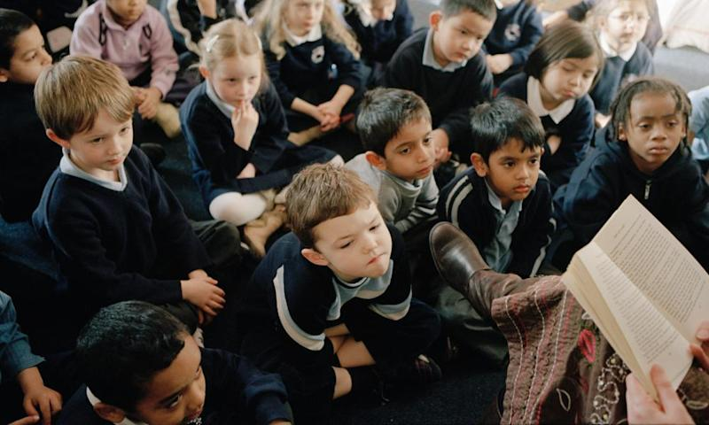 Primary school children listening to a story