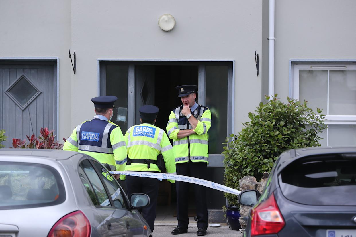 Gardai at a property in Clashmore, Co Waterford, where a three-month-old baby girl has died after being attacked by a dog in the early hours of Monday. Picture date: Monday June 7, 2021.