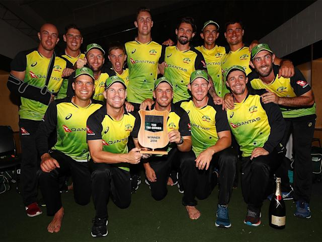 Australia celebrate their victory away from the rain: Getty