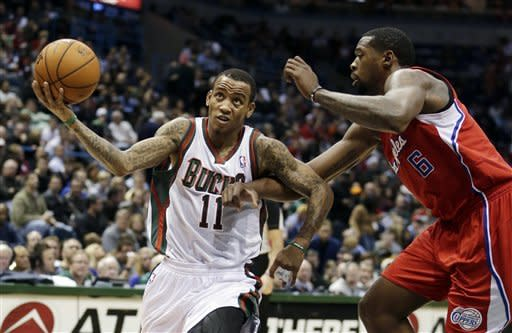 Milwaukee Bucks' Monta Ellis (11) is fouled by Los Angeles Clippers' DeAndre Jordan as he goes up for a shot during the second half of an NBA basketball game Saturday, Dec. 15, 2012, in Milwaukee. (AP Photo/Morry Gash)