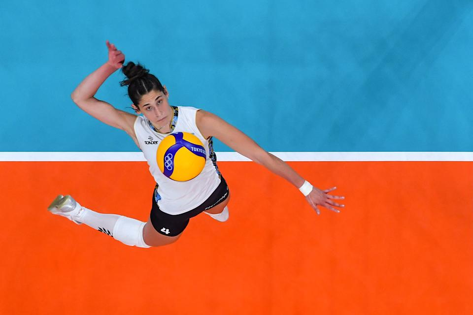 <p>TOPSHOT - Argentina's Daniela Bulaich Simian spikes the ball in the women's preliminary round pool B volleyball match between China and Argentina during the Tokyo 2020 Olympic Games at Ariake Arena in Tokyo on August 2, 2021. (Photo by Antonin THUILLIER / AFP) (Photo by ANTONIN THUILLIER/AFP via Getty Images)</p>