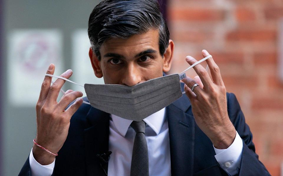 Rishi Sunak dons a face mask as he arrives at Wolverhampton Art Gallery during a visit to the city on Thursday