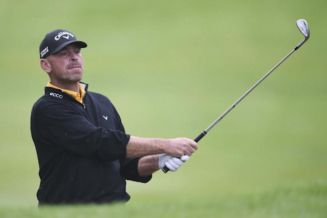 Denmark's Thomas Bjorn plays a shot during day three of the BMW PGA Championships at the Wentworth Club, Virginia Water England Saturday May 24, 2014.(AP Photo/Adam Davy/PA)
