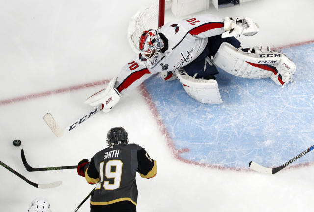 Washington Capitals goaltender Braden Holtby, right, stops a shot by Vegas Golden Knights right wing Reilly Smith during the third period in Game 2 of the NHL hockey Stanley Cup Finals on Wednesday, May 30, 2018, in Las Vegas. (AP Photo/John Locher)