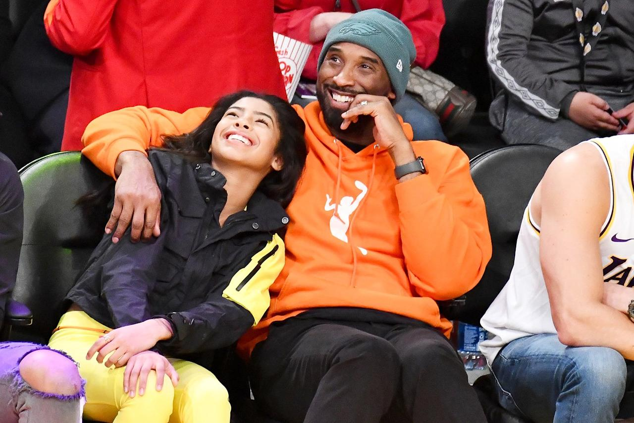 Kobe Bryant and daughter Gianna smile while watching the L.A. Lakers game on Sunday in California.
