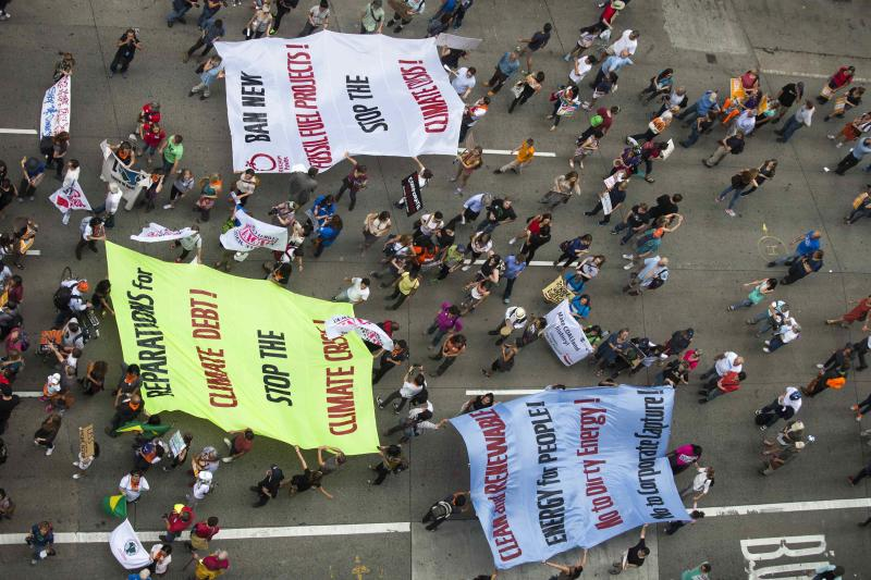Activists hold banners as they take part in the People's Climate March through Midtown, New York