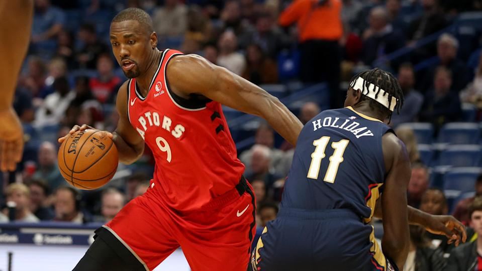 Nov 8, 2019; New Orleans, LA, USA; Toronto Raptors forward Serge Ibaka (9) drives around New Orleans Pelicans guard Jrue Holiday (11) in the first quarter at the Smoothie King Center. Mandatory Credit: Chuck Cook-USA TODAY Sports