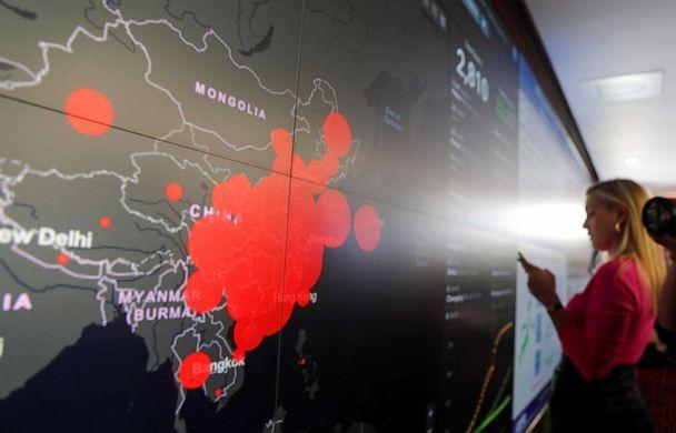 PHOTO: A reporter stands in front of a coronavirus global map during a tour of the 'secretary's operation center' as part of a coronavirus task force meeting at the Department of Health and Human Services in Washington, D.C., Feb. 27, 2020. (Carlos Barria/Reuters)