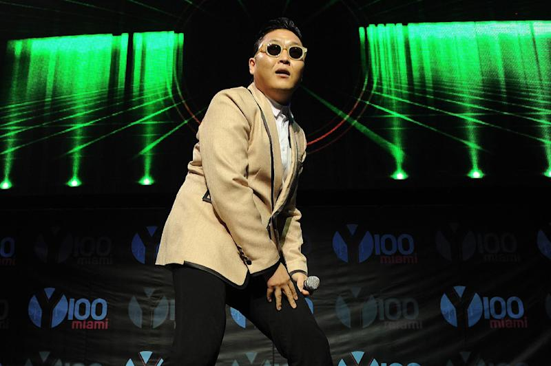 """FILE - This Dec. 8, 2012 file photo shows South Korean pop star PSY during the Y100's Jingle Ball 2012 at the BB&T Center in Ft Lauderdale, Fla. PSY's first new single since his viral hit """"Gangnam Style"""" is stealing attention from inter-Korean tensions. YG Entertainment, PSY's agency, says """"Gentleman"""" was released in 119 countries on Friday, April 12, 2013.  PSY co-composed the electronic dance music and wrote the lyrics for the song, which pokes fun at a self-claimed gentleman who enjoys his time at a dance club.  (Photo by Jeff Daly/Invision/AP, file)"""